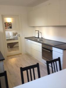 A kitchen or kitchenette at CPH Lux Apartments KH