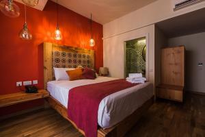 Un ou plusieurs lits dans un hébergement de l'établissement Murella Living