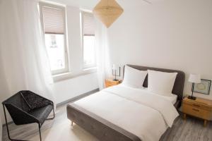 Ein Bett oder Betten in einem Zimmer der Unterkunft Altstadt Suite