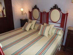 Ein Bett oder Betten in einem Zimmer der Unterkunft Al Vecchio Gelso