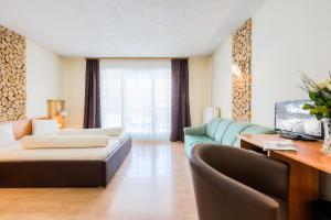 Ein Sitzbereich in der Unterkunft Hotel Laurenzhof