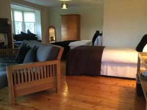 A bed or beds in a room at Sandhill House
