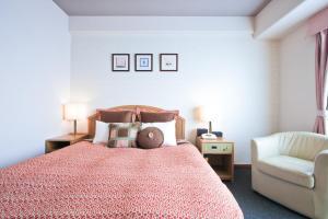 ホテルヴィラくれたけにあるベッド