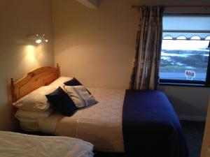 A bed or beds in a room at Sea View B&B
