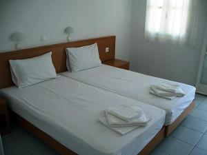 Ένα ή περισσότερα κρεβάτια σε δωμάτιο στο Kleopatra's Rooms