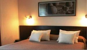 Una cama o camas en una habitación de Gran Hotel Provincial