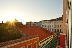 A balcony or terrace at Bairro Alto Suites