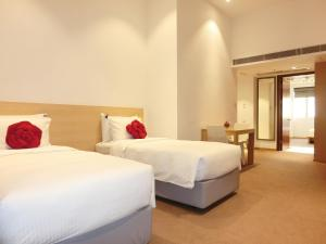 A bed or beds in a room at Butterfly on Prat Boutique Hotel Tsim Sha Tsui