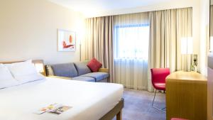 A bed or beds in a room at Novotel London Paddington