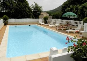 The swimming pool at or near Les Gardettes
