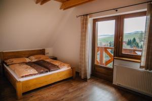 Posteľ alebo postele v izbe v ubytovaní Drevenica Huty