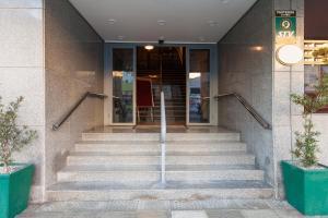 The facade or entrance of Tri Hotel Smart Caxias