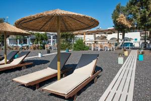 A porch or other outdoor area at Nissia Beach Apartments & Suites