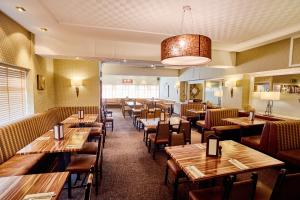 A restaurant or other place to eat at Abbotsford Hotel