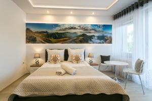 A bed or beds in a room at VIP Apartamenty Stara Polana 2