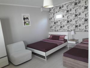 """Кровать или кровати в номере Гостиница """"Морская"""""""