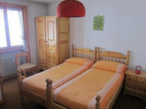 A bed or beds in a room at Casa Italo