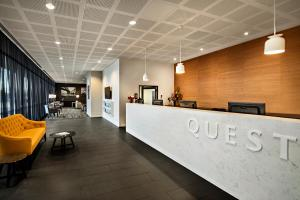 The lobby or reception area at Quest Bella Vista