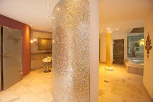 Ein Badezimmer in der Unterkunft Ferienhotel Haus Becker