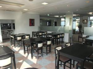 A restaurant or other place to eat at Hotel New Takahashi Kouyadai