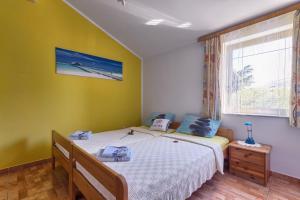 A bed or beds in a room at Apartments Ljiljana