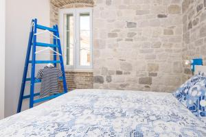 A bed or beds in a room at Apartments Kaja