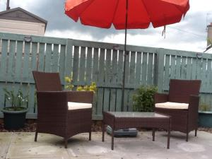 A porch or other outdoor area at West End Cottage