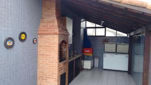 A cozinha ou cozinha compacta de Cobertura Duplex na Prainha em Arraial do Cabo
