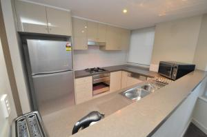 A kitchen or kitchenette at North Sydney Fully Self Contained Modern 2 Bed Apartment (2207BER)