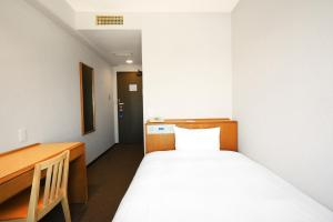 A bed or beds in a room at Smile Hotel Sugamo