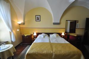 Posteľ alebo postele v izbe v ubytovaní Hotel Barbakan