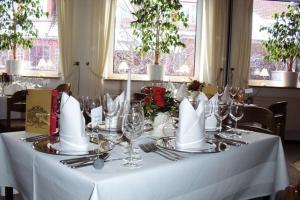 Ein Restaurant oder anderes Speiselokal in der Unterkunft Leibers Galerie-Hotel