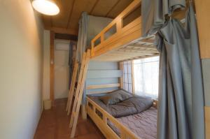 A bunk bed or bunk beds in a room at Akaishi Shouten