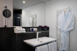 A bathroom at art'otel berlin mitte