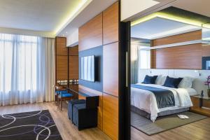 Um quarto em Radisson Hotel Curitiba