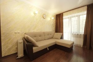 A seating area at Lenina 1G Apartment