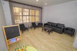 Гостиная зона в Апарт-Отель «Близнецы»