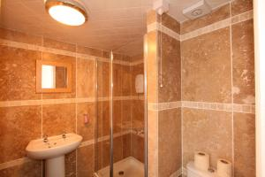 A bathroom at Central Studios Gloucester Road by RoomsBooked