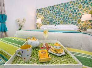 A bed or beds in a room at Relais Correale Rooms & Garden