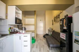 A kitchen or kitchenette at Downtown Hostel