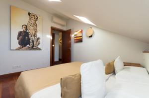 Cama o camas de una habitación en El Aura