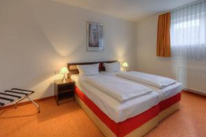 Ein Bett oder Betten in einem Zimmer der Unterkunft Sport- & Vital-Resort Neuer Hennings Hof