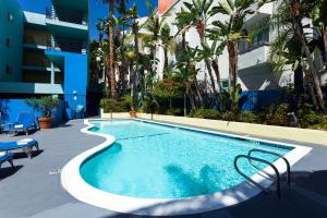 The swimming pool at or near Ramada Plaza by Wyndham West Hollywood Hotel & Suites