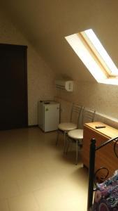 Кухня или мини-кухня в Mini-Otel Garibaldi