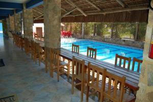 The lounge or bar area at Pousada Aqui é Para-Ti