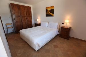 A bed or beds in a room at Agriturismo Lapone