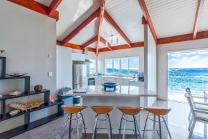 A kitchen or kitchenette at Ocean Spray Villas
