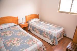 Cama o camas de una habitación en Cabañas Las Añañucas V