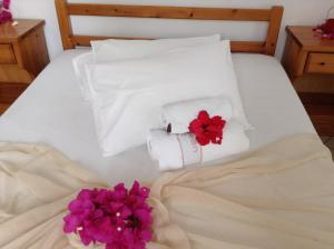 A bed or beds in a room at Arian Hotel