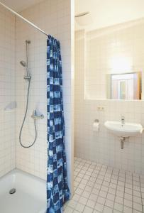 Ein Badezimmer in der Unterkunft Hotel Hottentotten